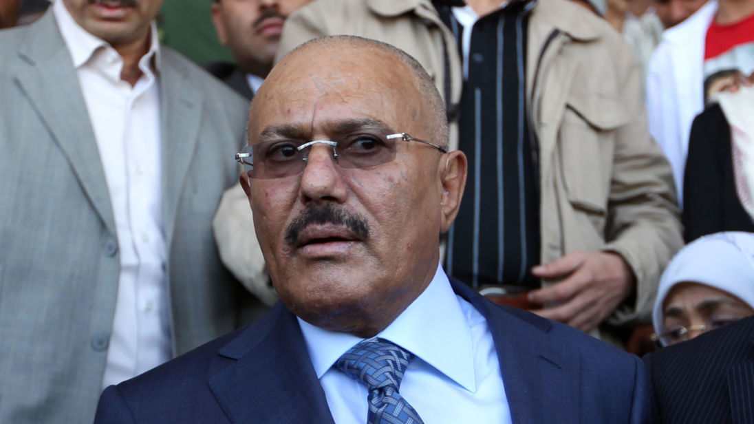 Former Yemeni president Ali Abdullah Saleh (L) and Yemen's Minister of Communications Ahmed Bin Daghr (R) attend celebrations on the occasion of the first anniversary of the handover of power in Sanaa on February 27, 2013. Saleh stepped down after 33-years at the helm in February 2011 and formally handed power to his then deputy, Abdrabuh Mansur Hadi. AFP PHOTO/ MOHAMMED HUWAIS        (Photo credit should read MOHAMMED HUWAIS/AFP/Getty Images)